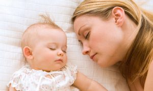 photo of mother and baby sleeping compassionate sleep solutions