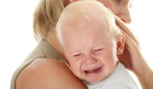 crying baby on mom's shoulder